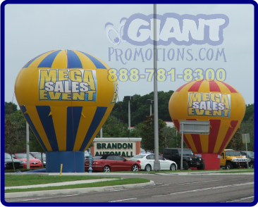 Two cold air giant inflatable advertising balloons.